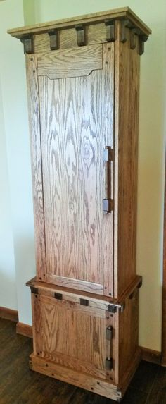 Arts & Crafts Style cabinet, made from oak with walnut accents. Doors are three-quarter inch solid oak panels. Finish is Minwax English Chesnut and satin polyurethane. Influences of Greene & Greene, Gustov Stickley, and James Krenov.