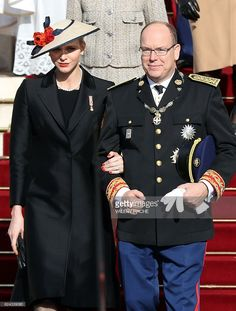 Prince Albert II of Monaco (R) and princess Charlene of Moanco (L) leave the cathedral after a mass during the celebrations marking Monaco's National Day, on November 19, 2016 in Monaco.  / AFP / VALERY HACHE        (Photo credit should read VALERY HACHE/AFP/Getty Images)