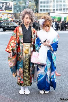 [Coming of Age Day Kimono in Japan 2014] Young women attending the official ceremonies throughout Japan traditionally wear formal Furisode kimono along with beautifully done hair and makeup. Young men occasionally wear kimono as well, although we more often see them in suits. #Shibuya