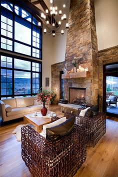 Love the view  Robert G. Sinclair Architecture, Inc. - Patio doors flank the indoor/outdoor fireplaces of the living room and veranda creating a seamless transition between indoor/outdoor entertaining.
