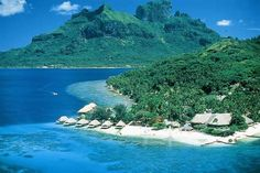 Bora Bora hotel (French Polynesia)--I am kissing ho-hum life away and going to plant myself right here for a while...honey--you can come if you want, but no hesitation, or you will be left behind!