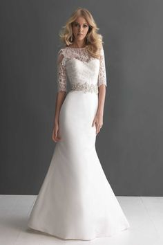 Style 2666 Neckline: Sweetheart Sleeve: 3/4 sleeve Train: Chapel Length Silhouette: A-line Fabric: Lace Taffeta