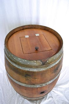 Hey, I found this really awesome Etsy listing at http://www.etsy.com/listing/125988945/wine-barrel-trash-can-w-removeable-lid