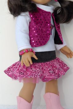 "American Girl 18 inch Doll Clothes White by TwirlyGirlDollDesign, $29.99  -SHIRT  .....white knit fabric with a star applique'  .....standup collar & long sleeves w/ pink stitching  VEST - reversible  .....pink confetti dot fabric on one side   .....black with sparkles on the other   SKIRT  .....black denim upper band  .....pink bandana print ruffle on bottom  .....a layer of pink tulle peeks out to increase the ""girlie"" quotient  .....elastic waist w/ tiny pink button marking the front"