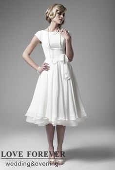 http://dyal.net/tea-length-wedding-dresses Tea Length Bridal Gown With Sleeves