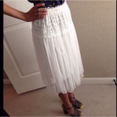 """White skirt Pre-loved and in good condition. Bought on posh & worn once and I think the original owner worn it once. 1st pic is from the original owner and second pic is me wearing it as a top. 65% cotton & 35% polyester. Waist approx 22"""" and stretches (elastic waistband) / length approx 23"""". top is selling in separate listingNo Trades, No PayPal, No Reserves Skirts"""