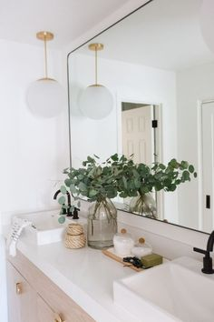 Interior stylist and designer Kristen Forgione of The LifeStyled Company designed this bright & beautiful bathroom with the Anna™ farmhouse sinks. Photography by Taylor Cole Photography