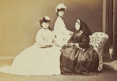Queen Victoria with Princess Alexandra princess of Wales behind and Princess Alice sat down. 1864