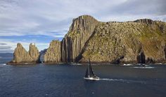 Limit sails past Tasman Island towards the finish line in Hobart during the Sydney to Hobart yacht race in Australia Sunday, Dec. 28, 2008.