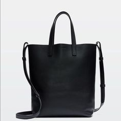 Large Auxiliary tote Perfect black tote with real leather. Long straps. Leather is soft and looks great with any outfit. Wear and tear on the leather still looks good. Perfect for travel too Auxilary  Bags Totes