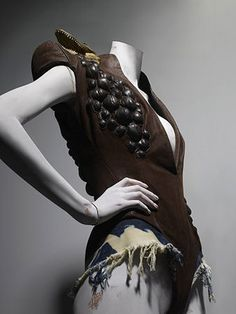 * Alexander McQueen (British, 1969–2010). Bodysuit t's a Jungle Out There, autumn/winter 1997–98. Brown leather with bleached denim and taxidermy crocodile heads. Photo Sølve Sundsbø