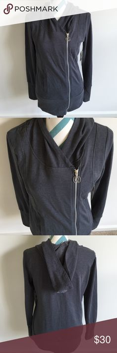 The Balance Collection Sweatshirt Beautiful charcoal gray hooded zip up sweatshirt. The material is super soft and stretchy. Made with 52% cotton, 45% polyester, 3% spandex. It is a longer fit. Measures 26 inches long. Brand new with tags! The Balance Collection Tops Sweatshirts & Hoodies