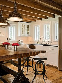 Rustic meets traditional meets hardcore architectural nerding.  The island base is an antique drafting table.