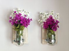 Etsy: Set of TWO Rustic Mason Jar Wall Sconces $34.  Or you can find a tutorial about how to make these at: http://rurallifestory.wordpress.com/2013/01/28/mason-jar-wall-vase-tutorial/