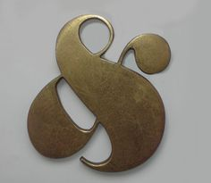 brass ampersand, designed for an editorial studio in New york by Herb Lubalin