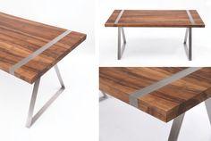 Ein geometrisches Zusammenspiel zwischen einem rechteckigem Holzplatte aus Nussbaum und dreieckigen Tischbeine aus Chromstahl. Die massive Holzplatte wird flächenbündig von zwei Flachstahlbänder, die im A-förmigen Design durchgehend verlaufen, umfasst.