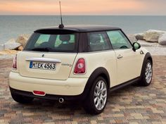 Cream Mini Cooper. if only it had the union jack on top :)