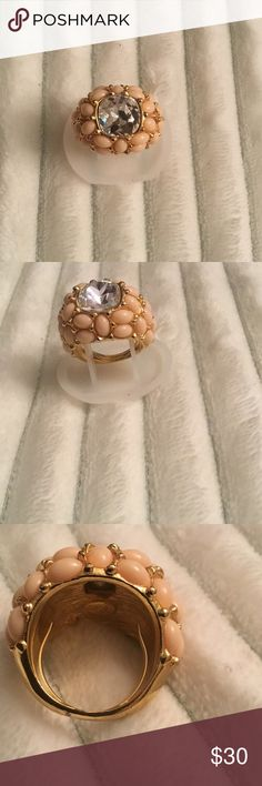 Kenneth Jay Lane Rhinestone ring Authentic Kenneth Jay Lane KJL clear and pink faux rhinestones ring. Size 7 expands to9, I took very good care of this ring looks gorgeous gold tone color with just a small minor discoloration that you can see in picture 4 Kenneth Jay Lane Jewelry