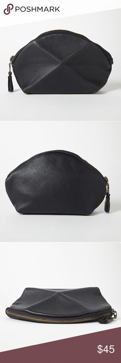 "SALE Black Pyramid Pouch This beautifully designed pouch is practical and fashionable! Made from beautiful Italian leather it features a 3 dimensional leather pleat in the front. Use it to store makeup or as a small clutch. Measures 4.3"" High x 7.8"" Wide x 1.5"" Deep. Fully Lined. Antique gold zipper with leather tassel. This pouch is from an online company I run which no longer sells this piece. It's handmade by an artisan called Lara Kazis and is brand new. Marks in leather are natural…"