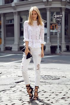 Summer Outfit Idea: White Jeans - feminine white lace paneled top with ruffles, styled with distressed white boyfriend jeans and sexy heeled lace-up sandals
