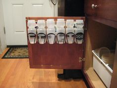 OOOO!  AHHH!  Waterbottle Organizational System...hidden inside your kitchen cabinet!  :)