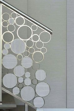 Circles of various sizes create this bubbly staircase railing.