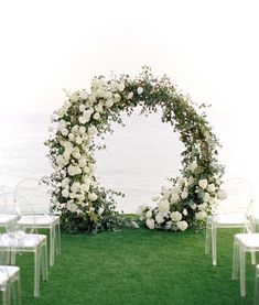 Beautiful modern circle arch with lush white blooms and organic greenery. #wedding #ceremony #circlearch #arch #flowers