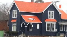 Just when you think u are the biggest fan, you see this! Broncos house in Packers Country!  Cool!