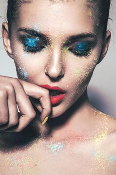 It's your makeup. Make it messy if you want to. Stand out with bright blue eyeshadow, bold red lips, yellow nail polish, and a splash of color.
