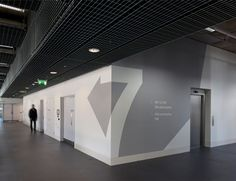 Number and directional wall signs at Ravensbourne, London, UK by JohnsonBanks