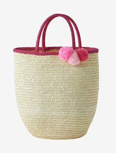 This basket with its tassels is so pretty, perfect as a decorative bedroom accessory, and so handy for storing their favourite toys and stuffed animals!   SIZE: Height 35 x width 32 cm  Handle and edging in contrasting pink colours. 3 different pink tassels on the side.    Made of natural fibre.;