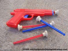 Pistola de plástico con dardos de ventosa