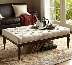 Upholstered with natural linen and detailed with deep button tufting, this ottoman offers great style at an exceptional value. Use it as casual seating or as a coffee table with a tray placed on top.