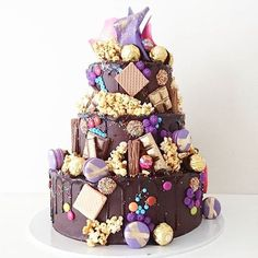 3 Tier Hero Cake with pink and purple chocolate crown