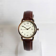 Couples watch,Wrist watch, Women Watch, Leather Watch ,Birthday gift, special gift Type: Japan Quartz Material: Glass Case Material: Metal Case Diameter: 3.1CM (small size for woman) 4.2CM (big size for man) Band Material: Real Leather Watchband: 12cm-22.4cm(small size for woman)