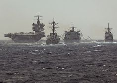 The aircraft carrier USS Enterprise (CVN 65), the guided-missile cruiser USS Vicksburg (CG 69), and the Arleigh Burke-class guided-missile destroyer USS Porter (DDG 78) participate in an replenishment at sea with the Military Sealift Command fast combat support ship USNS Supply (T-AOE 6).