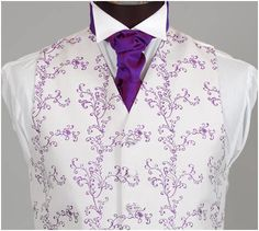 your man can wear an vibrant purple accented tie with a lightly purple detailed vest!