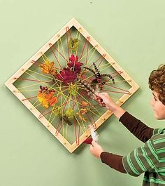 Create a frame with wooden canvas pieces, scrap wood, round eye screws to run the yarn or colored string through and take off weaving with nature.