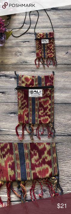 "Bali Ayu Martini Collection Passport Bag Boho From the Ayu Martini Collection, this bag is Handmade in Bali from beautiful sturdy woven fabric, includes a functional pouch with zipper and a long strap so you can wear it as a crossbody or tie it to the desired length. Fringe along bottom and fabric in maroon, blue and creamy yellow give it a great boho look that is perfect for festivals or summer travel. Offers warmly received. (CMM7A)  Size: approx 6 1/4"" x 8"" Ayu Bags Crossbody Bags"