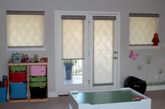 Hunter Douglas roller shades in the kids playroom