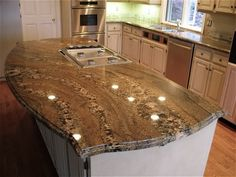 We've been searching for granite. We plan to do a medium reddish brown wood floor (Somerset Maple Merlot is our front runner) and kraftmaid maple cabinets (prailine is our current fav). We've been searching for a granite with flow. I really don't want anything that appears overly speckled. Some sant...