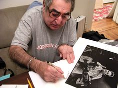 Rock Photographer Jim Marshall signing a print of Johnny Cash. Jim Marshall, Celebrity Photography, Johnny Cash, Music Icon, The Beatles, Icons, Age, Rock, Celebrities