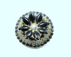 Vintage Rhinestone and Blue Stone Flower Brooch pin. $20.00, via Etsy.