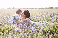 mom and baby outside in flowers - I have to do this with Jake!!