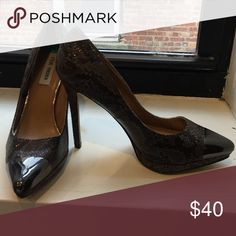 Snakeskin pumps Size 8 snakeskin pumps with metallic toe. 4 inch heel. Worn once. Would be cute dressed down with jeans or dressed up with a little black dress! Steve Madden Shoes Heels