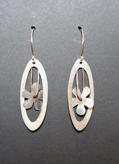 Sterling Silver oval earrings with a hanging flower by Colorado Artist Jennie Milner! On display and for sale at Outnumbered Gallery in Downtown Littleton, Colorado!