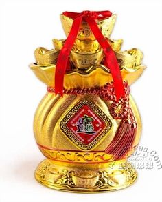 """Today's feature product: Chinese New Years Ingots Candy Jar w LED Lights  Considered to be the most important occasion in Chinese culture, preparations for the New Year generally begin several days before New Year's Eve. There is a great emphasis on decorating doorways leading into the home with Auspicious Cutouts.  • made from PVC   • 7.25"""" length x 5.75"""" width x 10"""" height   • operates on 3 """"AA"""" batteries (not included)  http://www.asianideas.com/chnewyecaja.html"""