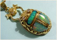Stunning opal scarab makes me want to work with both - the stone and the beetle!