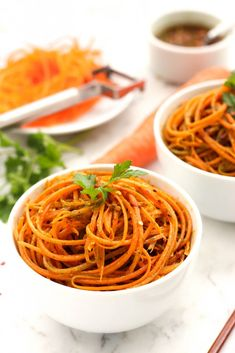 Carrot Noodles in Spicy Chimichurri Sauce / 5 medium-sized carrots 1 cup fresh parsley ½ cup fresh basil leaves ¼ cup chopped fresh spring onions 3 large garlic cloves, roughly chopped ¼ cup white vinegar ⅔ cup neutral vegetable oil 4 tablespoons of crushed red chilli pepper flakes (reduce the amount if you prefer it less spicy) Salt to taste