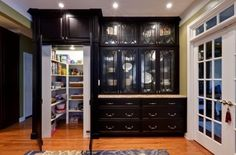 Walk-in pantry...I just love the black cabinets!